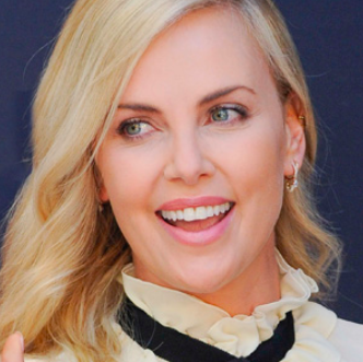 Charlize Theron Back in Action After Dental Surgery